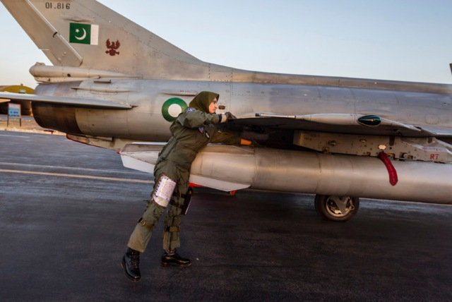 Ayesha Farooq, 26, Pakistan's only female war-ready fighter pilot, performs a pre-flight check on a Chinese-made F-7PG fighter jet at Mushaf base in Sargodha