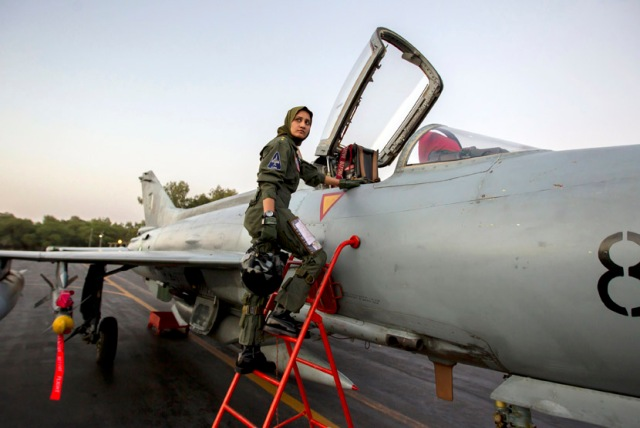 Ayesha Farooq, 26, Pakistan's only female war-ready fighter pilot, climbs up to a Chinese-made F-7PG fighter jet at Mushaf base in Sargodha