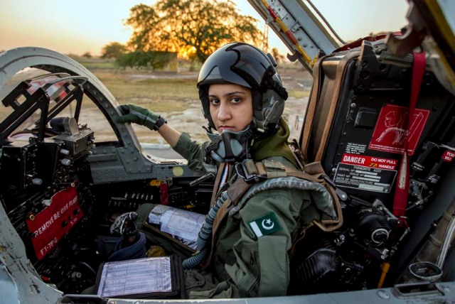Ayesha Farooq, 26, Pakistan's only female war-ready fighter pilot, poses for photograph as she sits in a cockpit of a Chinese-made F-7PG fighter jet at Mushaf base in Sargodha