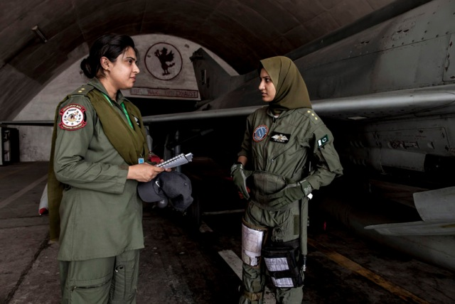Ayesha Farooq, 26, Pakistan's only female war-ready fighter pilot, talks with avionics engineer Anam Hassan, 24, at Mushaf base in Sargodha
